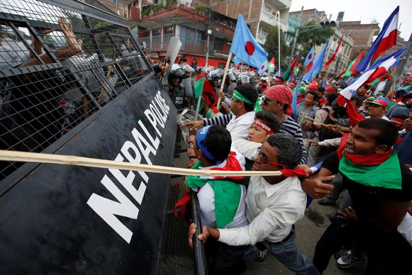 Supporters of Federal Alliance, a coalition of Madhes-based parties and other ethnic political parties and organizations, protest against the constitution near Singha Durbar office complex that houses the Prime Minister's office and other ministries in Kathmandu, Nepal, May 15, 2016. REUTERS/Navesh Chitrakar