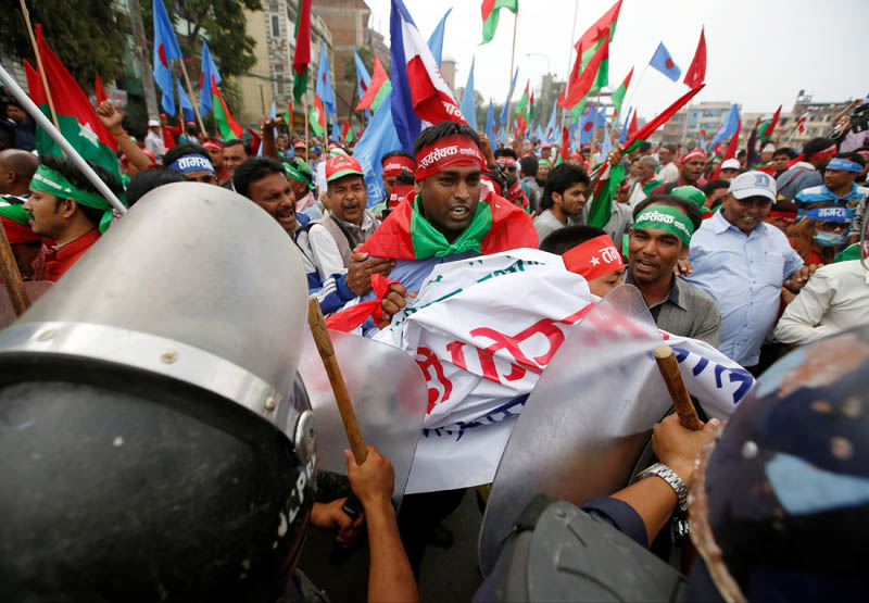 Supporters of Federal Alliance, a coalition of Madhes-based parties and other ethnic political parties and organisations, protest against the constitution near Singha Durbar office complex that houses the Prime Minister's office and other ministries in Kathmandu, Nepal, May 15, 2016. REUTERS