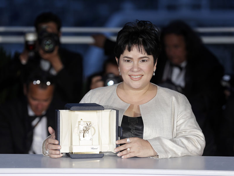 Actress Jaclyn Jose poses for photographers after winning the Best Actress award for the film Ma'Rosa, during the photo call following the awards ceremony at the 69th international film festival, Cannes, southern France, on Sunday, May 22, 2016.Photo:Lionel Cironneau/AP