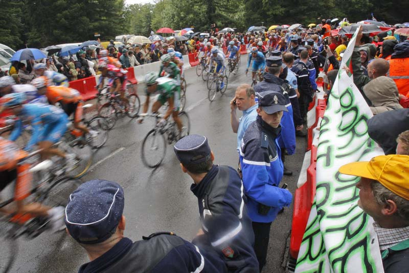 French police holding back demonstrating harbour workers during the third stage of the Tour de France cycling race between Saint-Malo and Nantes, western France, on Monday July 7, 2008. Photo: AP/ File