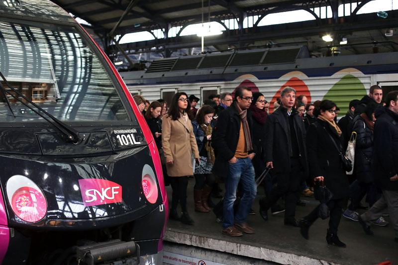 Commuters arrive at the Gare de l'Est train station in Paris, on Tuesday, April 26, 2016. Photo: Thibault Camus/AP