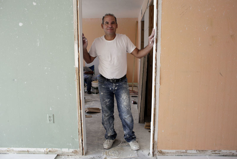 Edgar Ospina (50) poses for a photo where he is remodeling an apartment in Miami Beach, Florida, on Monday, April 25, 2016. Photo: Lynne Sladky/AP