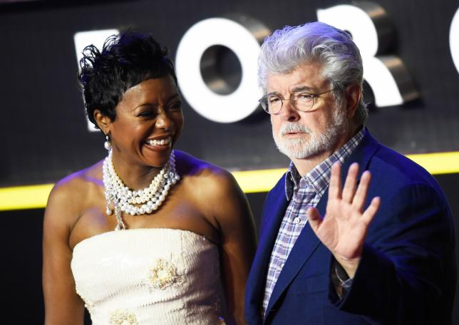 George Lucas and his wife Mellody Hobson arrive at the European Premiere of Star Wars, The Force Awakens in Leicester Square, London, Britain,  December 16, 2015.       REUTERS/Dylan Martinez/Files