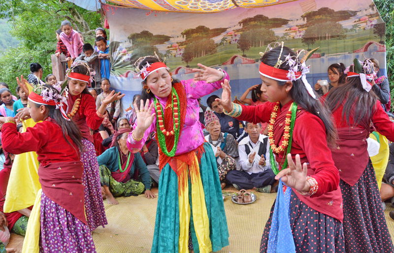 Members of the Magar community clad in traditional attires perform Ghatu Nach in Pandabkhani of Baglung district on Monday, May 23, 2016. Photo: RSS