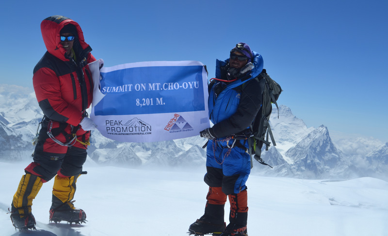 Two members of an Indian expedition team from Giripremi, a mountaineering club, pose for a photograph after scaling the Mount Cho Oyu, on May 14, 2016. Photo: Giripremi