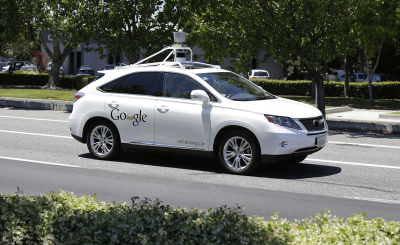 FILE - A Google self-driving car goes on a test drive near the Computer History Museum in Mountain View, California, on May 13, 2014. Photo: Eric Risberg/AP