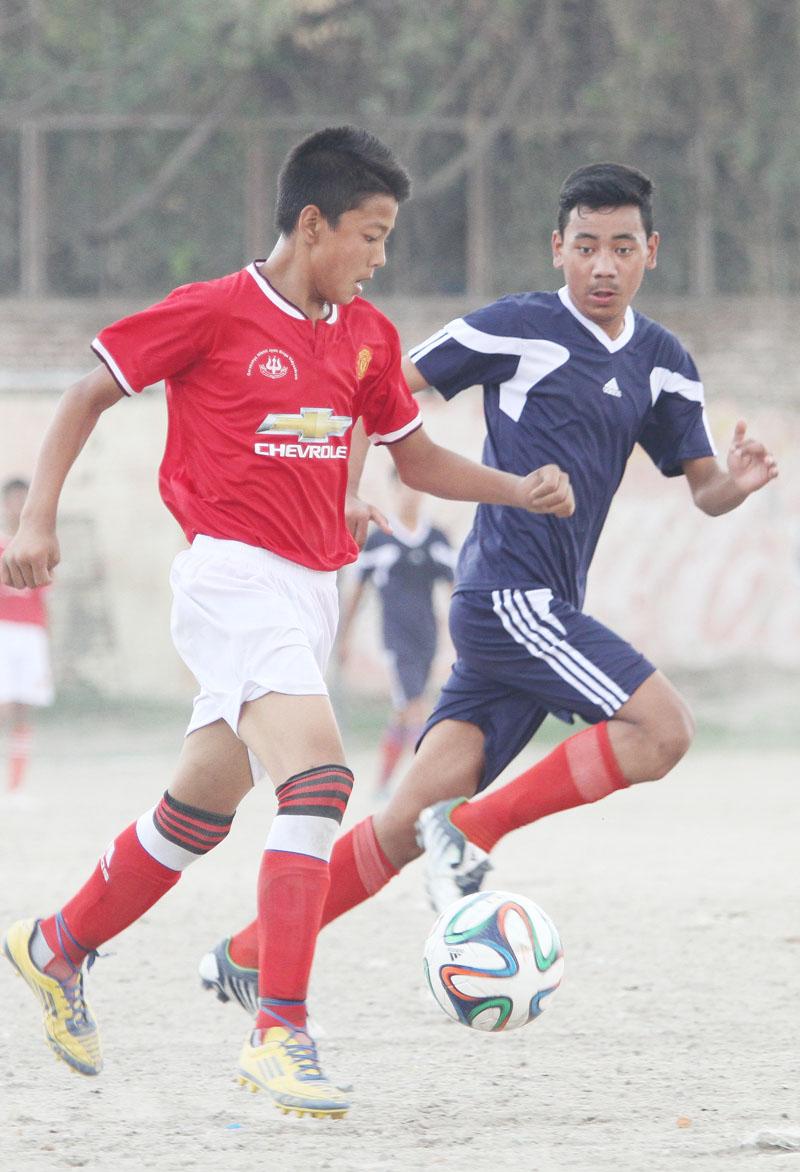 Players of Goraksha Nikhil Jyoti Dibya Vidhyashram and Aagaman Academy (right) vie for the ball during their Coca-Cola Cup Inter-school Football Tournament match in Kathmandu on Monday, May 23, 2016. Photo: Udipt Singh Chhetry/THT