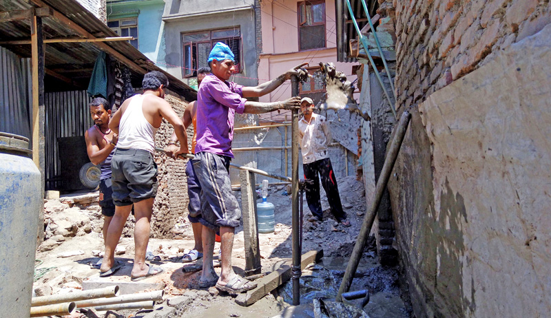 FILE - Locals of Nhyokha digging the earth to instal a shallow tubewell, contributing to the depletion of groundwater level in the Kathmandu Valley over the years, on Wednesday, May 11, 2016. Photo: THT