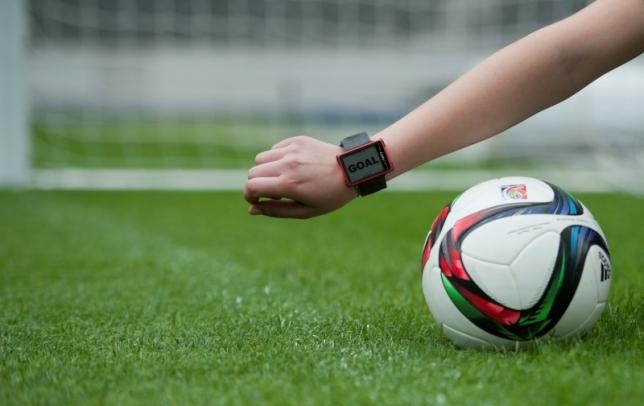 A Hawk-Eye staff member presents a wristwatch used as a part of the Hawk-Eye goal-line technology, which will be used for the first time in Germany during the Saturday's German Cup final (DFB Pokal) at the Olympic stadium in Berlin, in this May 26, 2015 file photo.  REUTERS/Stefanie Loos