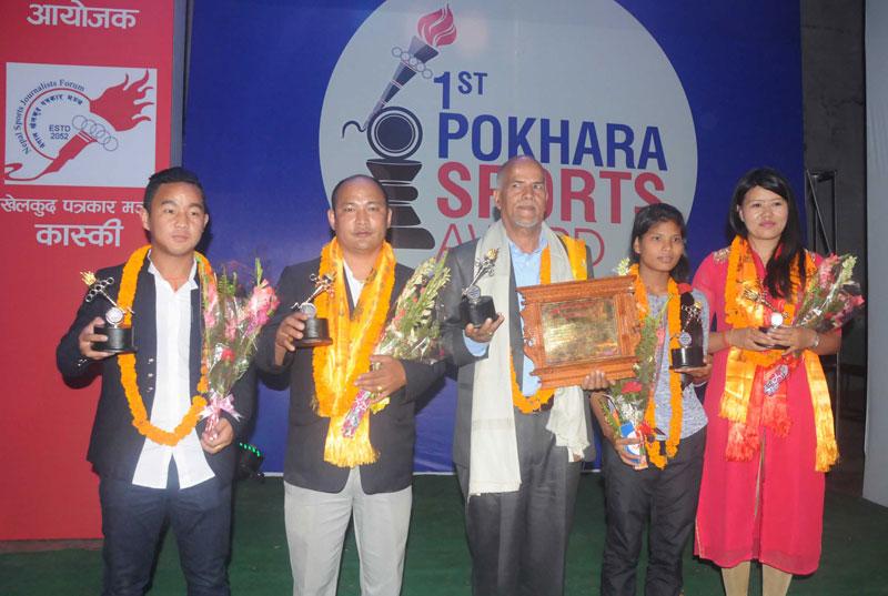 (From left) Footballer Heman Gurung, karate coach Surendra Gurung, football coach Krishna Thapa, athlete Shashi Chaudhary and spiker Manju Gurung after being honoured by Kaski nCoordination Committee of Nepal Sports Journalists Forum in Pokhara on Saturday. THT
