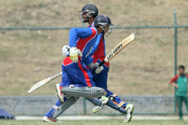 Rit Gautam (left) and Dilip Nath of Himalayan White House College run between the wickets during their Expert College Premier League match against NTHMC of Pokhara in Kathmandu on Saturday, April 30, 2016. Photo: THT