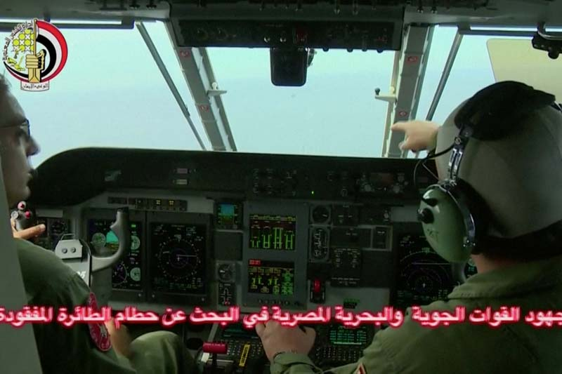 An Egyptian pilot (right) points during a search operation by Egyptian air and navy forces for the EgyptAir plane that disappeared in the Mediterranean Sea, in this still image taken from video on May 20, 2016. Photo: Egyptian Military via Reuters TV