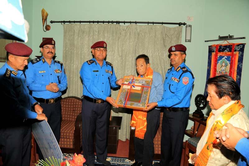 Nepal police IGP Upendra Kant Aryal honours veteran musician Amber Gurung at  the latter's residence, in Budhanilakantha Municipality-6, on Wednesday, May 25, 2016. Photo: Nepal Police