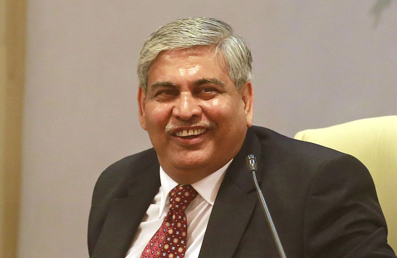 FILE- Board of Control for Cricket in India (BCCI)'s newly elected president Shashank Manohar smiles during a press conference in Mumbai, India, on October 4, 2015. Photo: Rafiq Maqbool/AP