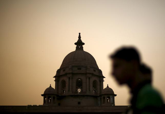 A commuter walks past the building of India's Ministry of Finance during dusk in New Delhi, India, in this May 18, 2015 file photo. REUTERS/Adnan Abidi/Files
