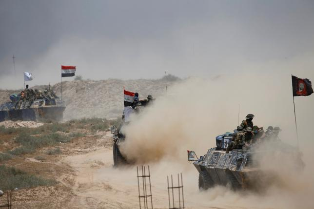 Iraqi federal police advance with Shi'ite fighters towards Falluja, Iraq, May 24, 2016. REUTERS/Thaier Al-Sudani