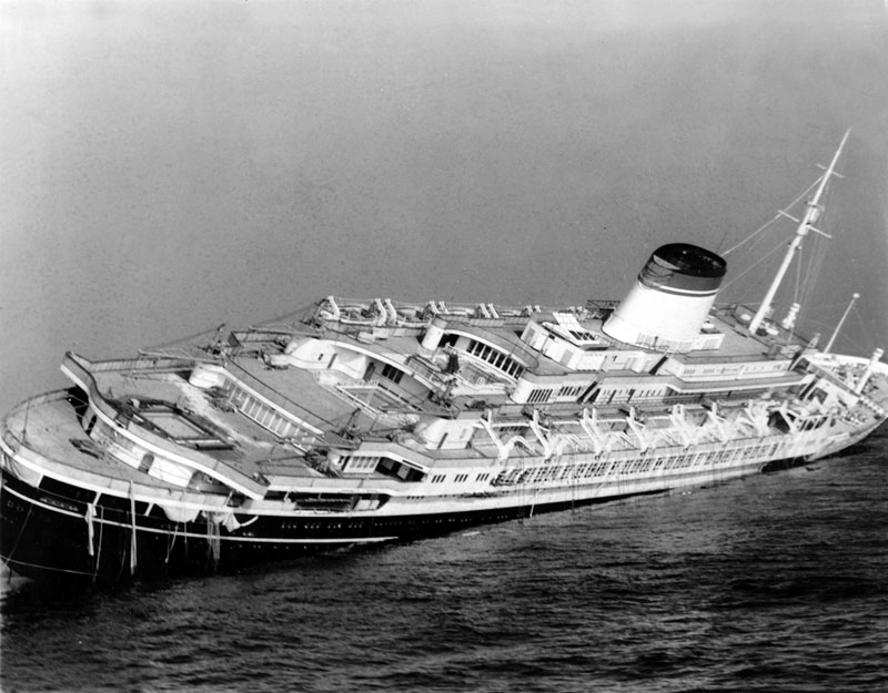 FILE - on July 26, 1956 file photo, The Italian luxury liner Andrea Doria keels far over to starboard before sinking 225 feet to the bottom of the Atlantic 45 miles off Nantucket Island, Massachusetts, on July 26, 1956. Photo: John Rooney/AP File