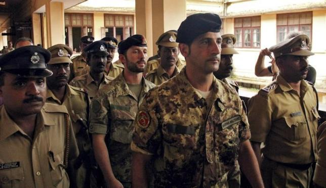 Salvatore Girone (C) and Latorre Massimiliano (3rd R), members of the navy security team of Napoli registered Italian merchant vessel Enrica Lexie, are escorted as they leave a courtroom at Kollam in Kerala March 5, 2012. Photo: Reuters