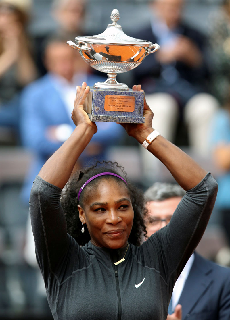 Serena Williams of the US holds the trophy after winning the Italian Open in Rome on Sunday,  May 15, 2016. Photo: Reuters