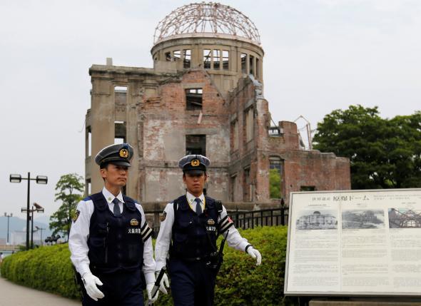Police officers guard in front of the Atomic Bomb Dome at Peace Memorial Park in Hiroshima, Japan May 27, 2016.  REUTERS/Toru Hanai