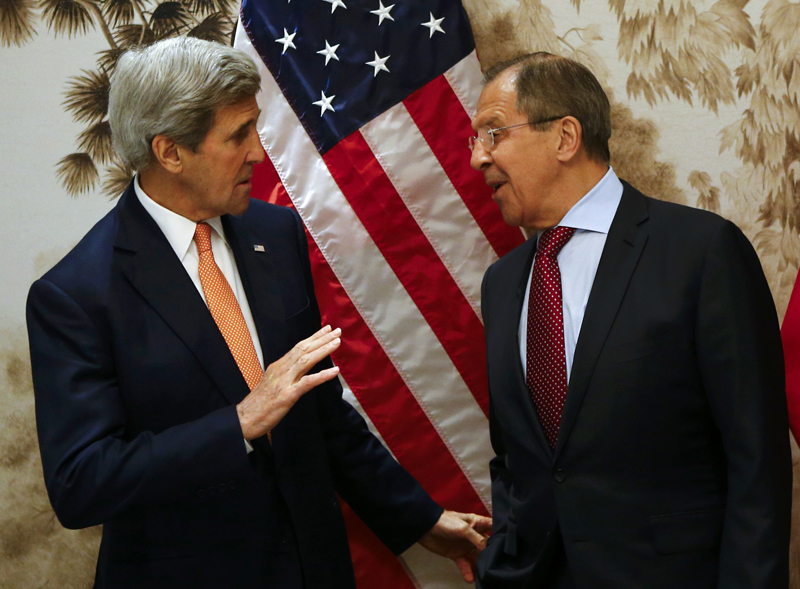 US Secretary of State John Kerry and Russian Foreign Minister Sergey Lavrov, right, arrive for  a meeting in Vienna, Austria, Monday May 16, 2016. Photo: AP