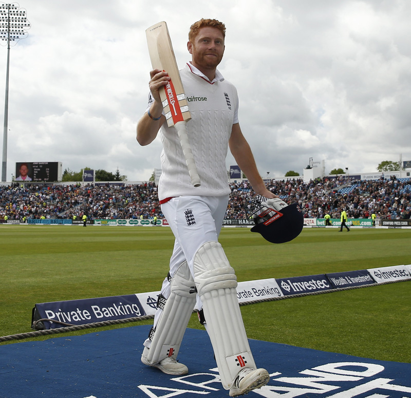 England's Jonny Bairstow celebrates his century as they walk off for tea during 1st Test Match against Sri Lanka at Headingley on Friday, May 20, 2016. Photo: Reuters