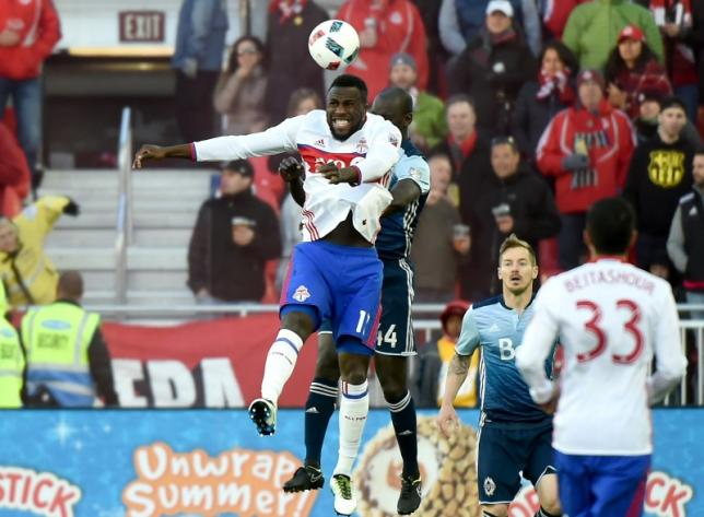 May 14, 2016; Toronto, Ontario, CAN;   Toronto FC forward Jozy Altidore (17) plays a header in front of Vancouver Whitecaps defender Pa-Modou Kah at BMO Field. Mandatory Credit: Dan Hamilton-USA TODAY Sports