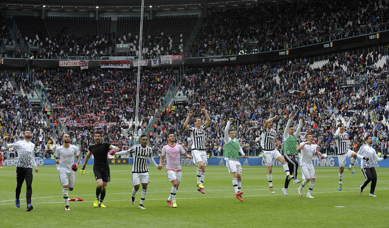 Juventus' players celebrate at the end of the match against Carpi. Photo: Reuters