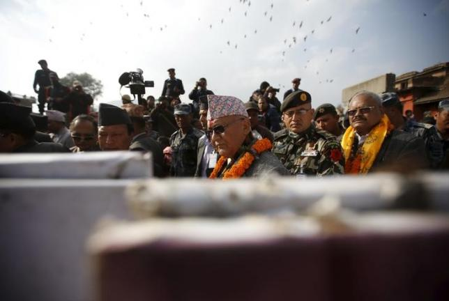 Nepal's Prime Minister Khadga Prasad Sharma Oli, also known as KP Oli (C), observes a master plan for the reconstruction of Bungamati village upon his arrival to take part in an event organised to mark the 18th National Earthquake Safety Day and the official launch of earthquake reconstruction efforts in Bungamati village, Nepal January 16, 2016. REUTERS/Navesh Chitrakar