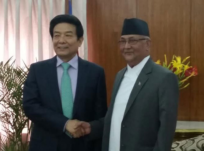 Prime Minister KP Sharma Oli shakes hands with China's Minister for State Administration of Press, Publication, Radio, Film and Television Cai Fuchao at the former's official residence in Baluwatar on Friday, 13 May 2016. Photo: PM's Secretariat
