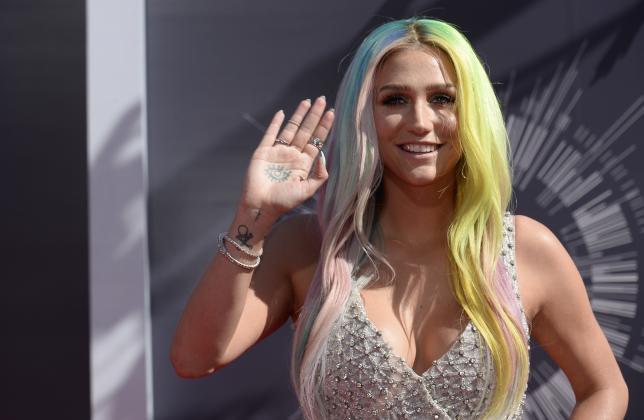 Singer Kesha arrives at the 2014 MTV Music Video Awards in Inglewood, California, U.S. August 24, 2014.   REUTERS/Kevork Djansezian/File Photo