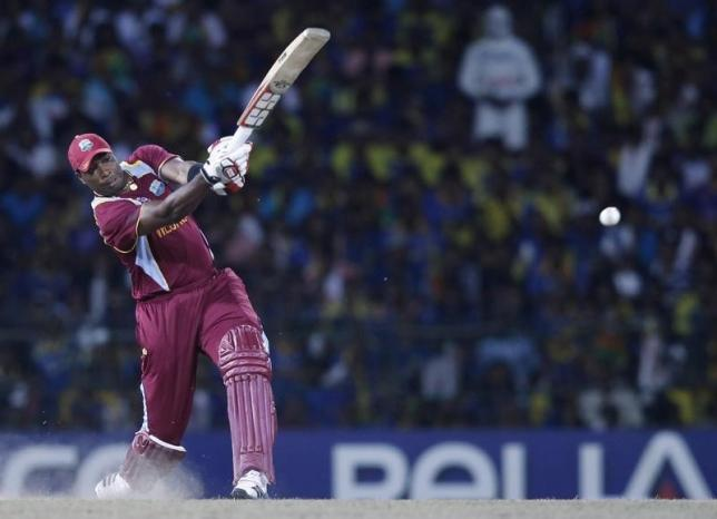 West Indies' Kieron Pollard plays a shot during their World Twenty20 final cricket match against Sri Lanka in Colombo October 7, 2012. REUTERS/Dinuka Liyanawatte/Files