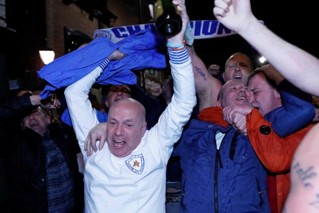 Britain Football Soccer - Leicester City fans watch the Chelsea v Tottenham Hotspur game in pub in Leicester - 2/5/16nLeicester City fans celebrate winning the Premier LeaguenReuters / Eddie KeoghnLivepic