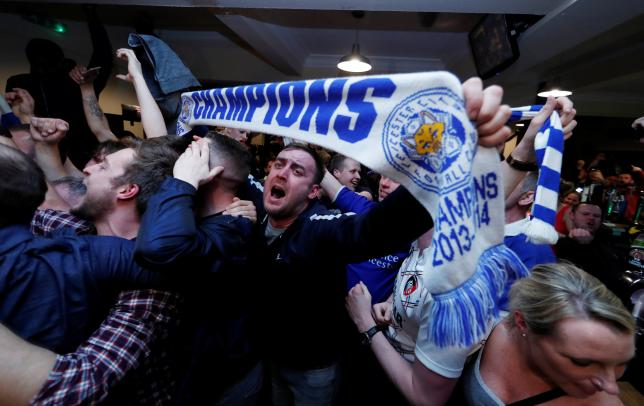 Britain Football Soccer - Leicester City fans watch the Chelsea v Tottenham Hotspur game in pub in Leicester - 2/5/16. Leicester City fans celebrate winning the Premier LeagueReuters / Eddie Keogh Livepic