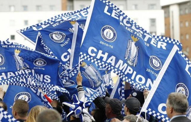 Britain Soccer Football - Leicester City celebrate winning Premier League title - Leicester - 3/5/16nLeicester City fans celebrate with flagsnAction Images via Reuters / Craig BroughnLivepic