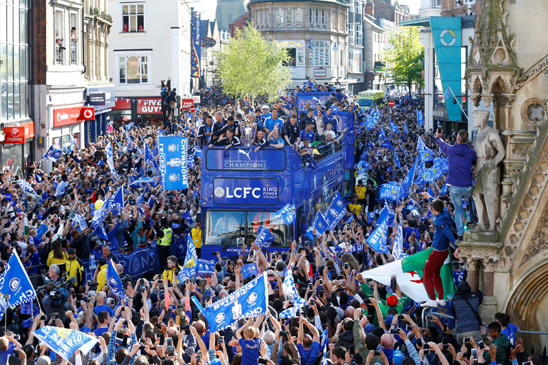 Leicester City celebrate with the trophy on the bus during the parade, on May 16, 2016. Photo: Reuters