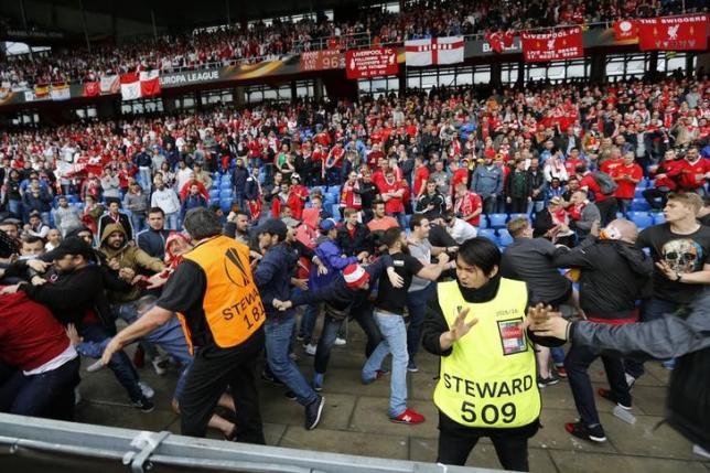 Football Soccer - Liverpool v Sevilla - UEFA Europa League Final - St. Jakob-Park, Basel, Switzerland - 18/5/16nFans clash before the gamenReuters / Marcelo del PozonLivepic