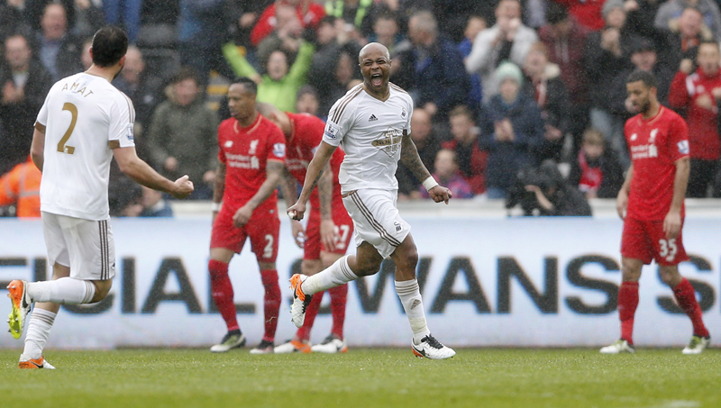 Swansea's Andre Ayew celebrates scoring their third goaln aginst Liverpool during Barclays Premier League game at Liberty Stadium on Sunday, May 1, 2016. Photo: Reuters