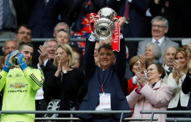 Britain Football Soccer - Crystal Palace v Manchester United - FA Cup Final - Wembley Stadium - 21/5/16nManchester United's manager Louis van Gaal celebrates  winning the FA Cup with the trophynAction Images via Reuters / Jason Cairnduff