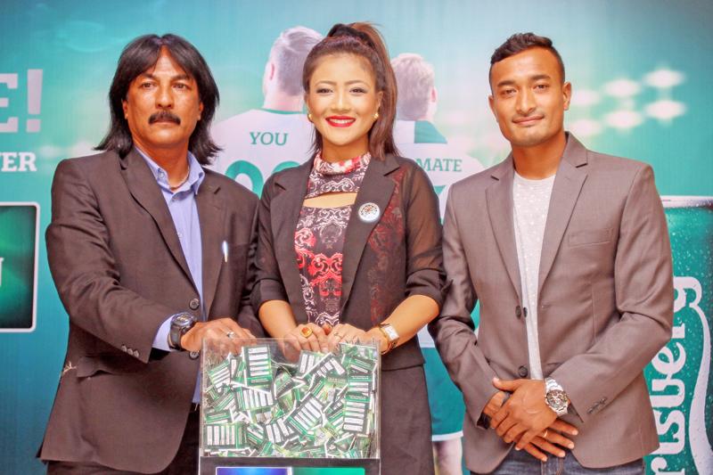 Raju Kaji Shakya-Nepal National Football Team Coach, Evana Manandhar-Miss Nepal World 2015 and Biraj Maharjan-Nepal National Football Team Captain conducting lucky draw of 'Live it Live! probably the best France ever', in Thamel of Kathmandu on Tuesday, May 10, 2016. Photo: THT