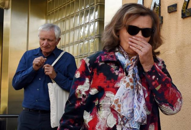 The parents of a victim from Malaysian Airlines Flight MH17 react as they leave the State Coroners Court, after the New South Wales State Coroner handed down his findings from an inquest into the deaths of six New South Wales residents who were aboard the plane, in Sydney, Australia, May 17, 2016.    AAP/Dean Lewins/via REUTERS