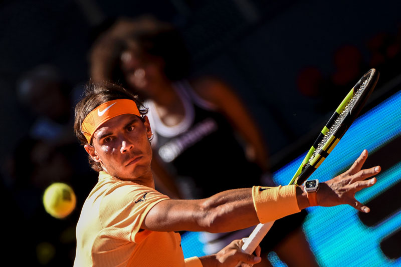 Rafael Nadal of Spain returns to Andrey Kuznetsov of Russia during their Madrid Open match at the Caja nMagica sports complex in Madrid on Tuesday, May 3, 2016. Photo: AFP