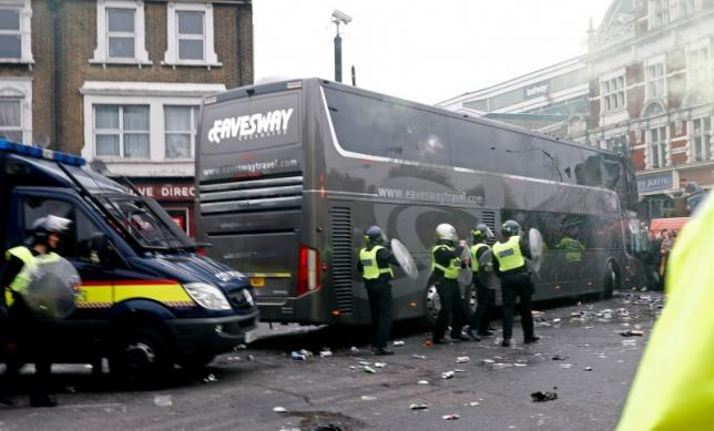 Britain Soccer Football - West Ham United v Manchester United - Barclays Premier League - Old Trafford - 10/5/16nGeneral view as bottles are thrown at the Manchester United team bus before the matchnReuters / Eddie KeoghnLivepic