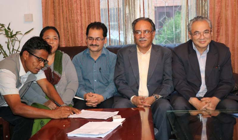 Leaders of various Maoist parties sign an agreement to unify their parties, in Kathmandu, on Saturday, May 14, 2016. Photo: Pushpa Kamal Dahal Secretariat