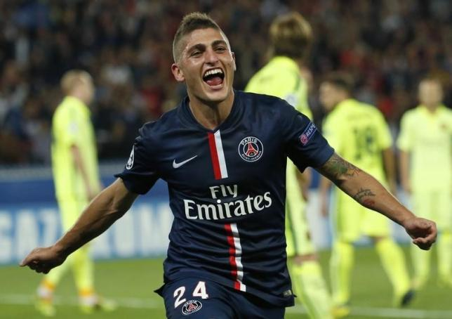 Marco Verratti celebrates after scoring against Barcelona during their Champions League Group F soccer match against Barcelona at the Parc des Princes Stadium in Paris, September 30, 2014. REUTERS/Benoit Tessier/Files