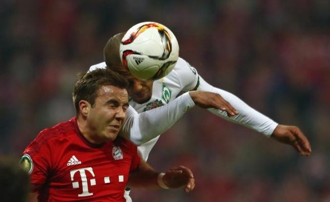 Football Soccer - Bayern Munich v Werder Bremen  - German Cup (DFB Pokal) - Allianz Arena, Munich, Germany - 19/04/16   Bayern Munich's Mario Goetze and Werder Bremen's Gebre Selassie in action. REUTERS/Michael Dalder/Files