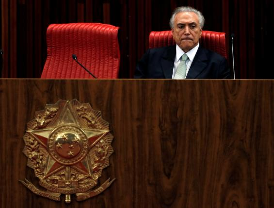 Brazil's interim President Michel Temer reacts during the inauguration ceremony of Gilmar Mendes (not in the picture) as the new president of the Superior Electoral Court in Brasilia, Brazil, May 12, 2016. REUTERS/Paulo Whitaker