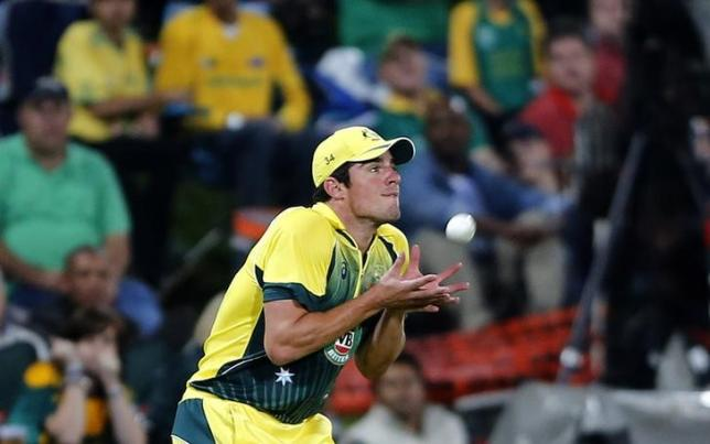 Australia's Moises Henriques makes a catch to dismiss South Africa's JP Duminy during the final of the T20 cricket test match in Centurion, March 14, 2014.  REUTERS/Siphiwe Sibeko/Files