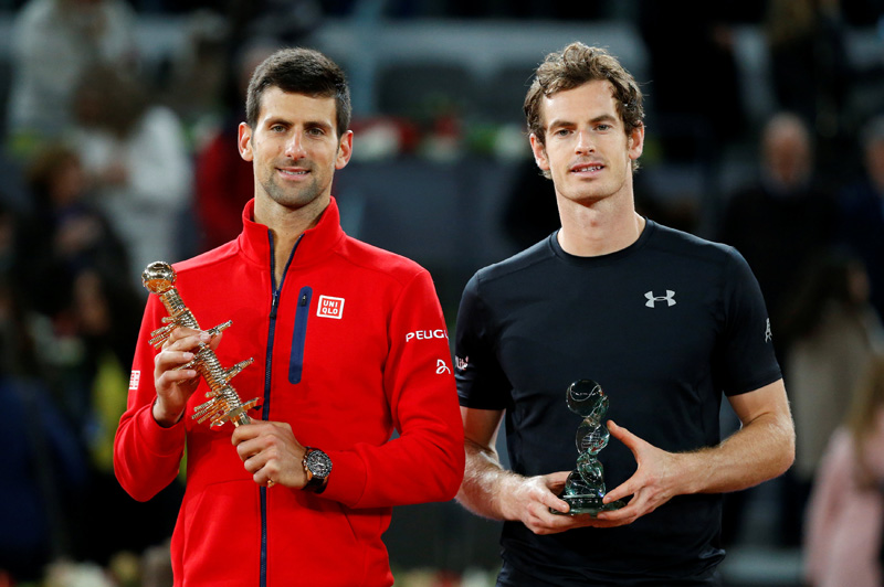 Djokovic and Murray pose with their trophies after Madrid Open Tennis Final in Madrid on Sunday, May 8, 2016. Photo: Reuters