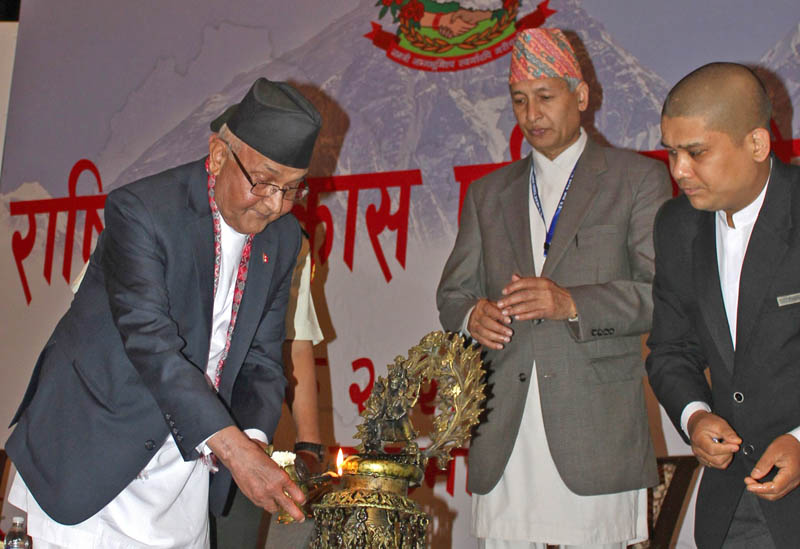 Prime Minister KP Sharma Oli lights Panas lamp while inaugurating the meeting of National Development Council in Kathmandu on Sunday, May 15, 2016. Photo: RSS